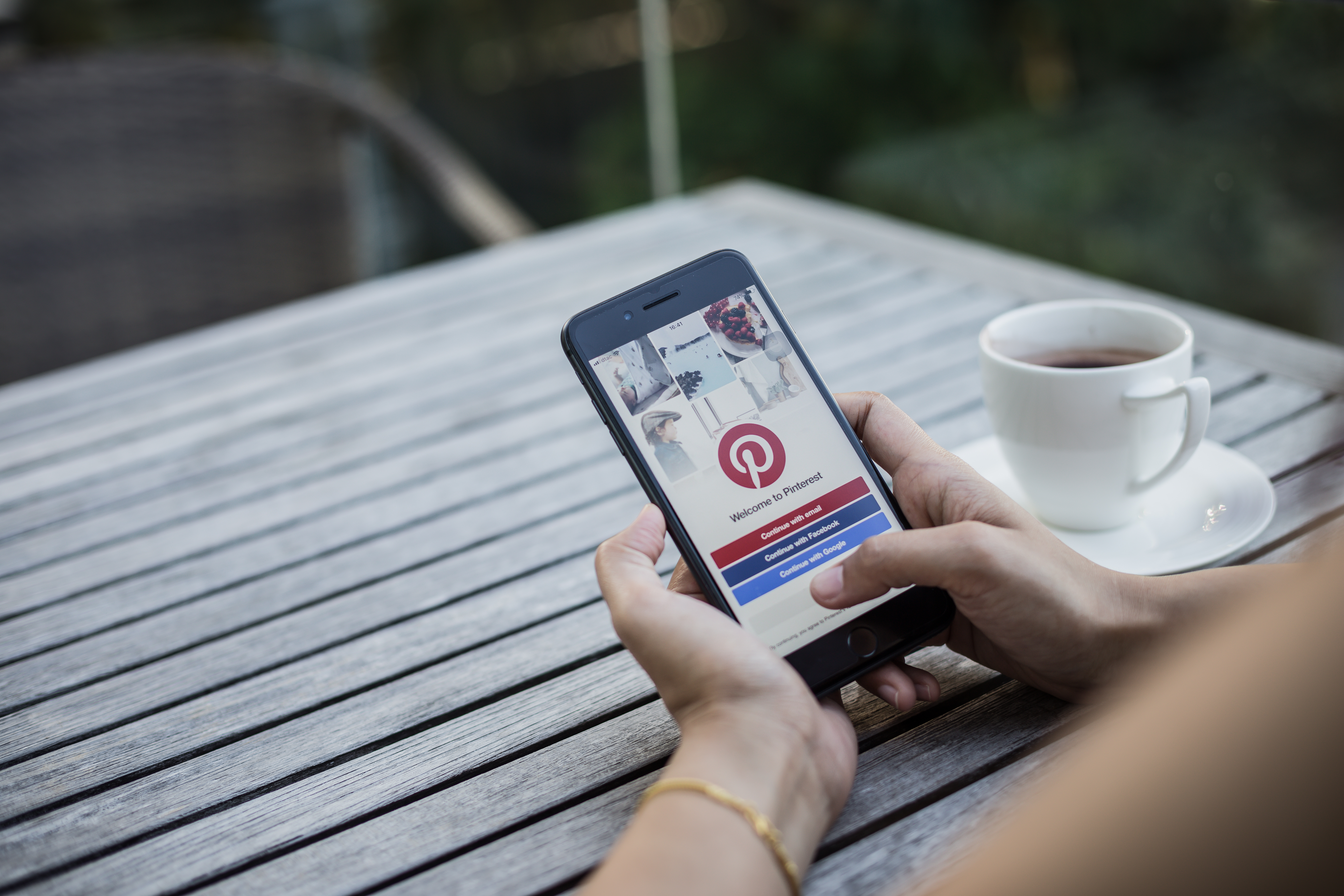 Apple-iPhone-8-Plus-showing-Pinterest-application-on-mobile.-It-was-held-by-woman-hand-in-cafe-shop.-958110282_5472x3648